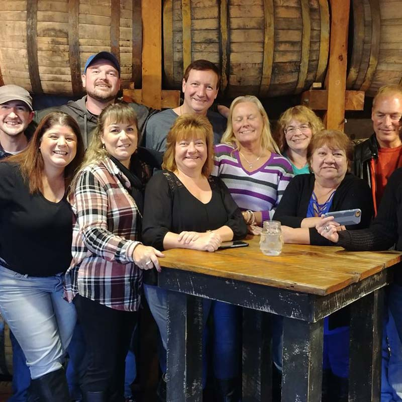 Group in barrel room
