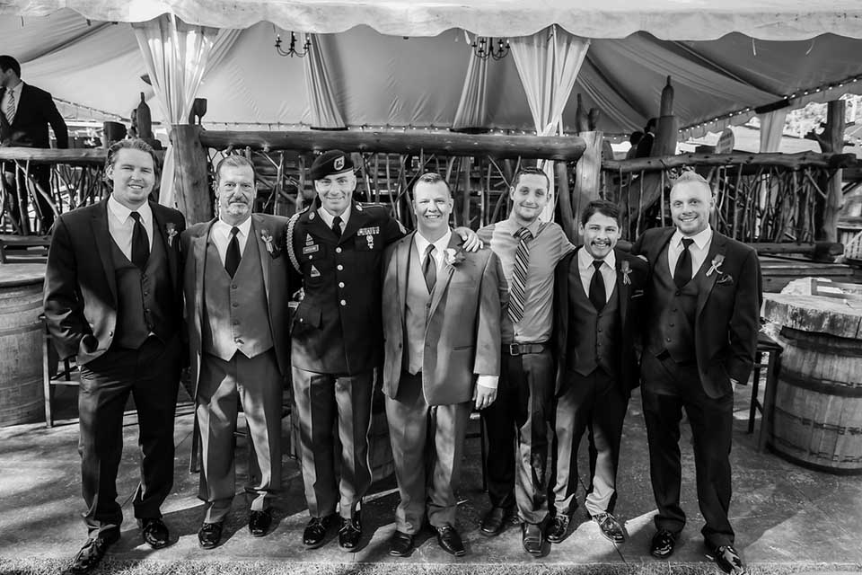 Groomsmen posing for photo with groom