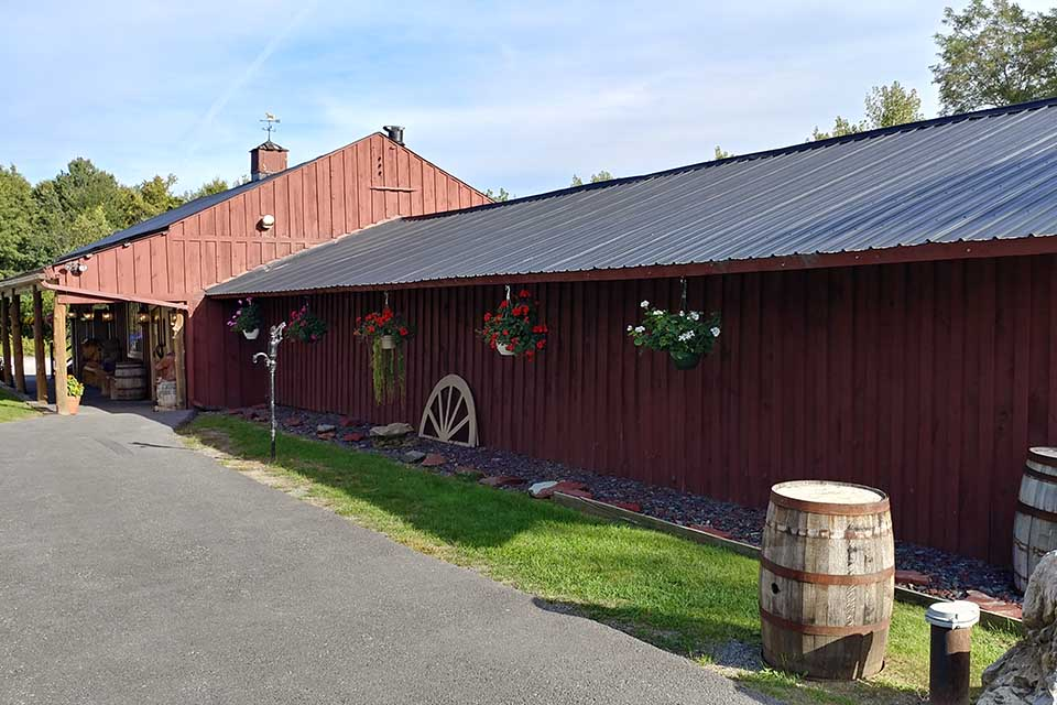 Red building with board and batten siding and metal roof