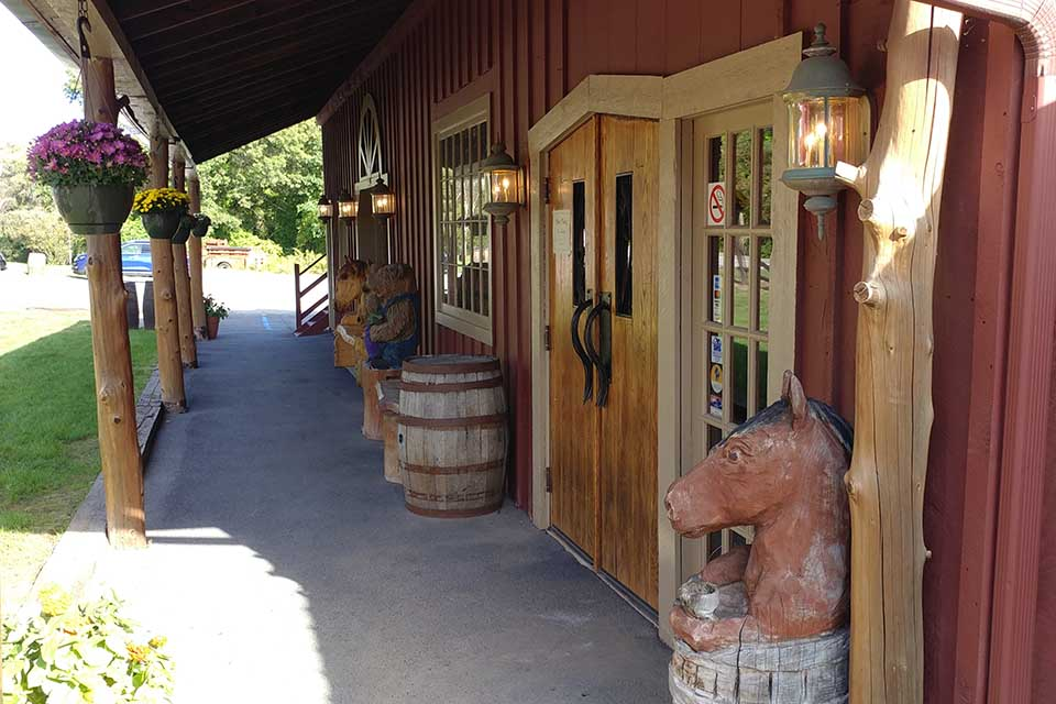 entrance to winery with wood carved animals