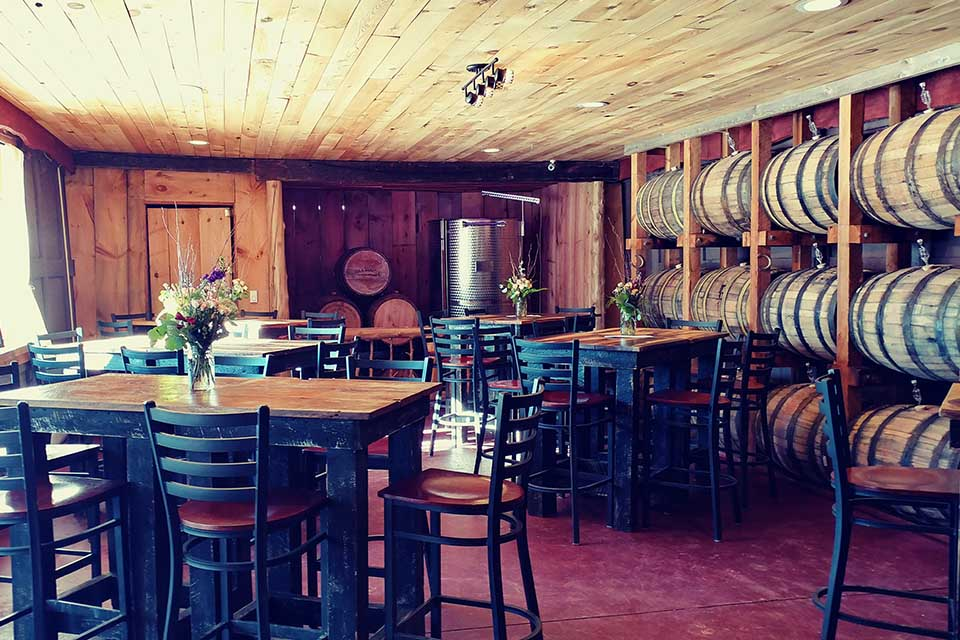 Seating area with wine barrels on wall