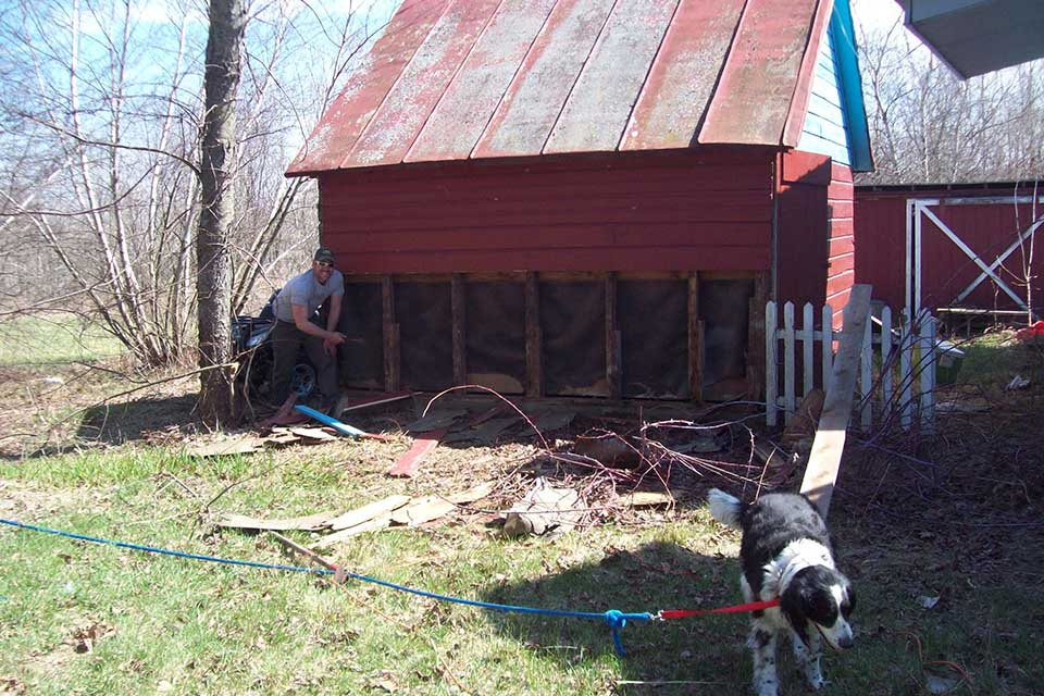 Construction on old small red barn