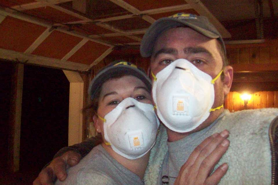 Couple in construction facemasks